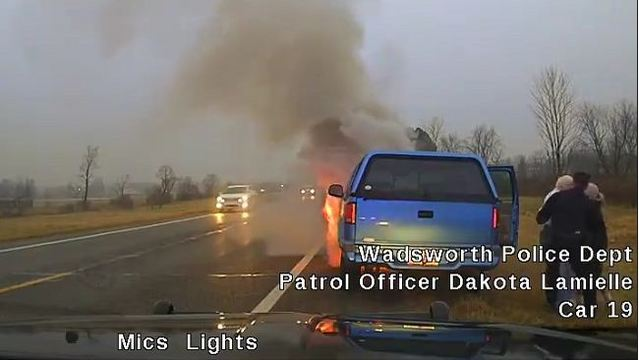 WATCH: Ohio officer carries woman to safety seconds before truck bursts into flames