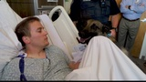Officer's Best Friend: K-9 partner visits his wounded Auburn Officer in hospital